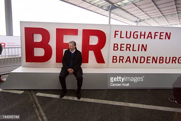 Berlin«s major Klaus Wowereit sits in front of the new sign of the airport at the open house weekend next to the construction site of the main...