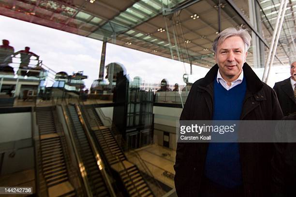 Berlin's major Klaus Wowereit stands in front of the entrance to the terminal at the open house weekend next to the construction site of the main...