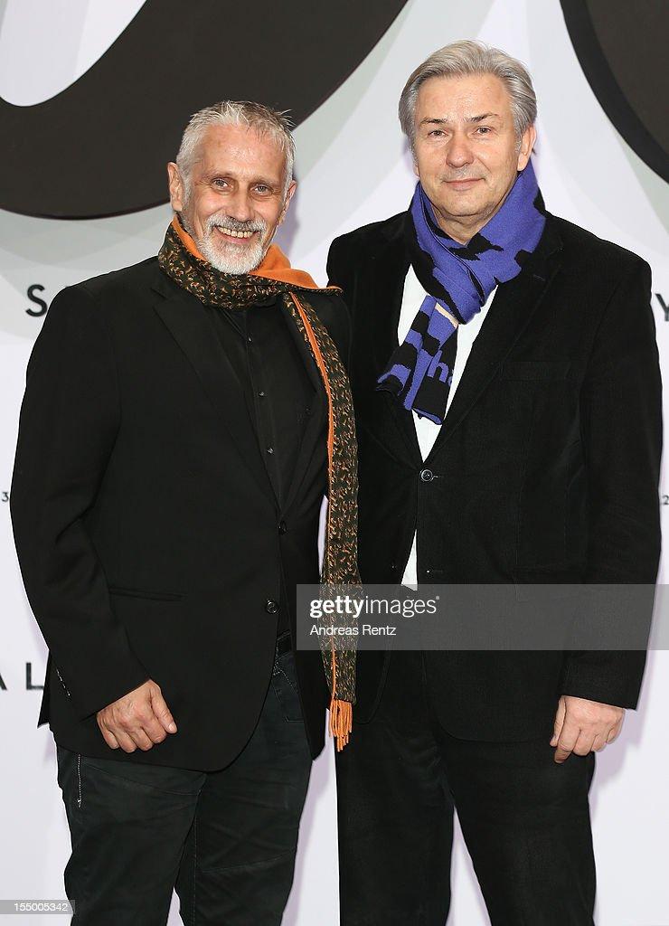 Berlins mayor Klaus Wowereit (R) and partner Joern Kubicki (L) attend the 'Skyfall' Germany premiere at Theater am Potsdamer Platz on October 30, 2012 in Berlin, Germany.
