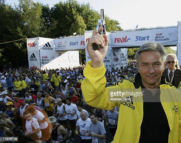 Berlin's Mayor Klaus Wowereit poses with a starting pistol at the start of the 33th Berlin Marathon on September 24 2006 in Berlin Germany