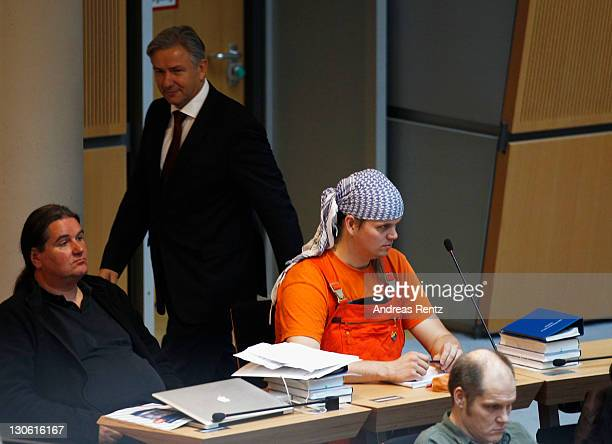 Berlin's mayor Klaus Wowereit walk past The Piratenpartei delegates Pavel Mayer and Gerwald ClausBrunner during the first session of the Berlin City...