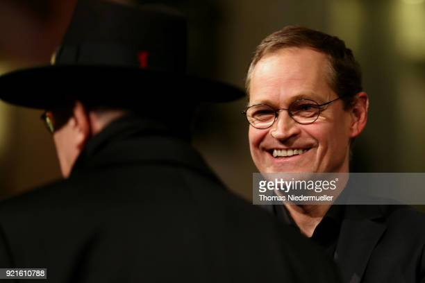 Berlin's mayor Michael Mueller and festival director Dieter Kosslick attend the 'The Silent Revolution' premiere during the 68th Berlinale...