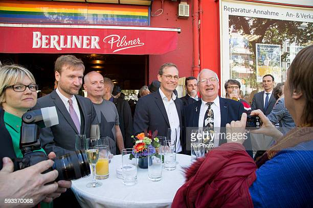 Berlin's Mayor Michael Mueller and former sound engineer of David Bowie in Berlin Eduard Meyer pose for a picture after attending an unveiling...