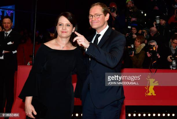 Berlin's mayor Michael Mueller and his wife Claudia pose on the red carpet upon arrival at the Berlinale Palace for the opening ceremony of the 68th...