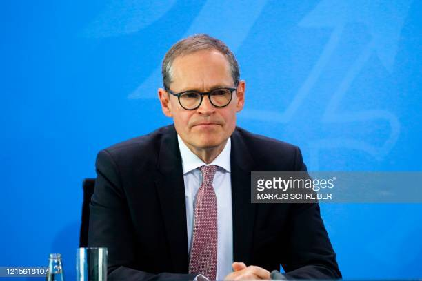 Berlin's Mayor Michael Mueller briefs the media after a meeting of former East German state governors with German Chancellor at the Chancellery in...