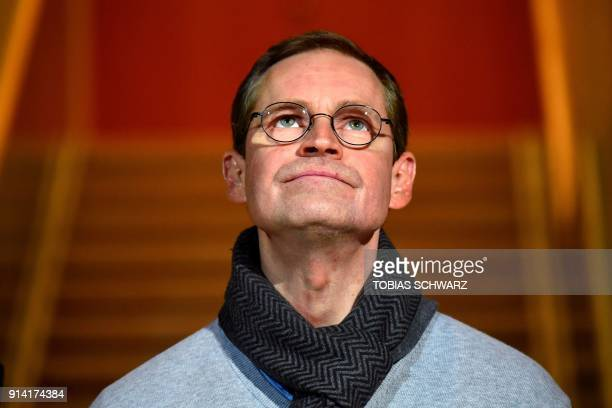 Berlin's mayor Michael Mueller looks up during a press statement at the Social Democratic Party headquarters on February 4 2018 in Berlin as German...