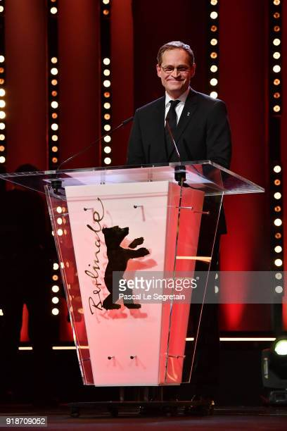 Berlin's mayor Michael Mueller speaks on stage at the Opening Ceremony 'Isle of Dogs' premiere during the 68th Berlinale International Film Festival...