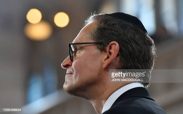 Berlin's mayor Michael Mueller wears a Jewish kippa skullcap as he attends a ceremony at the Synagogue Rykestrasse in Berlin on November 9 2018 to...