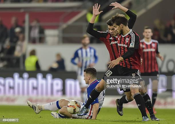 Berlin's midfielder Alexander Baumjohann and Ingolstadt's French defender Romain Bregerie vie for the ball with during the German first division...