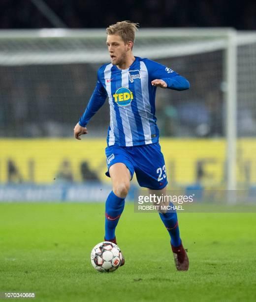 Berlin's midfielder Arne Maier runs with the ball during the German first division Bundesliga football match between Hertha Berlin v Eintracht...
