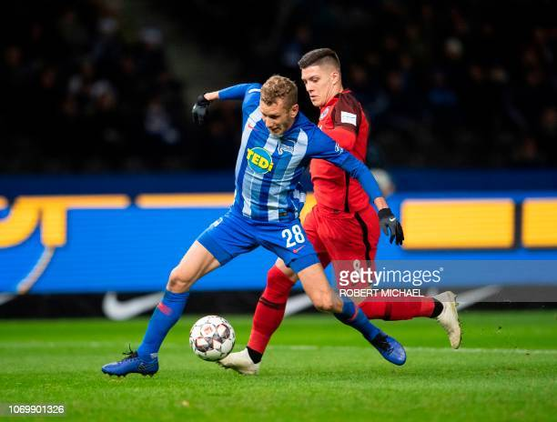 Berlin´s midfielder Fabian Lustenberger and Frankfurt´s Serbian forward Luka Jovic vie for the ball during the German first division Bundesliga...