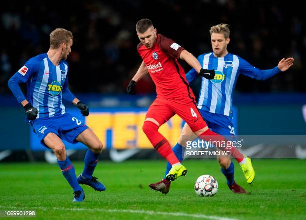 Berlin´s midfielder Fabian Lustenberger Berlin´s midfielder Arne Maier and Frankfurt´s Croatian midfielder Ante Rebic vie for the ball during the...