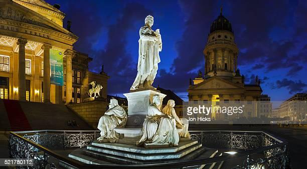 berlin's most graceful square, gendarmenmarkt, at night. - französischer dom stock pictures, royalty-free photos & images
