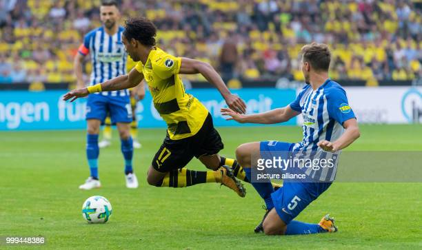 Berlin's Niklas Stark fouling Dortmund's PierreEmerick Aubameyang during the Bundesliga match pitting Borussia Dortmund vs Hertha BSC at the Signal...