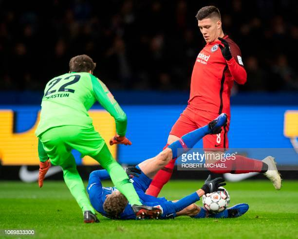 Berlin´s Norwegian goalkeeper Rune Jarstein midfielder Fabian Lustenberger and Frankfurt´s Serbian forward Luka Jovic vie for the ball during the...