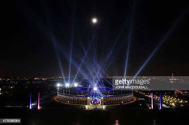 Berlin's Olympic Stadium is illuminated during the Night of Lights show on November 11 as part of the closing ceremony of the 75th anniversary of the...