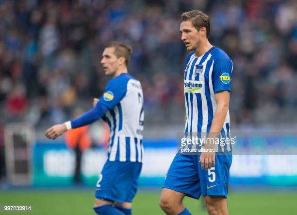 Berlin's Peter Pekarik and Niklas Stark walk across the pitch after the Bundesliga soccer match Hertha BSC vs FC Schalke 04 in Berlin Germany 14...
