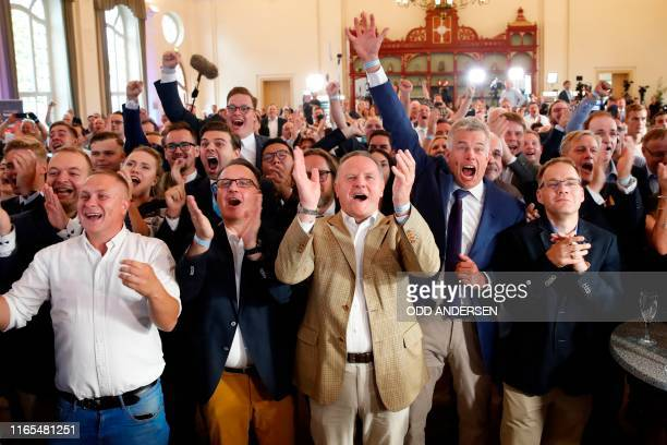 Berlin's representative of the Alternative for Germany farright party Georg Pazderski and party supporters and members react after the first exit...