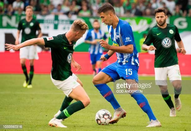 Berlin's Serbian midfielder Marko Grujic and Wolfsburg's German defender Yannick Gerhardt vie for the ball during the German First division...