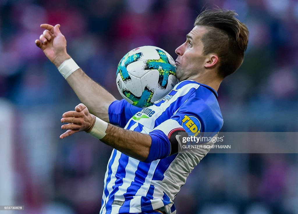TOPSHOT - Berlin's Slovakian defender Peter Pekarik plays the ball during the German first division Bundesliga football match Bayern Munich vs Hertha Berlin in Munich, southern Germany, on February 24, 2018. / AFP PHOTO / Guenter