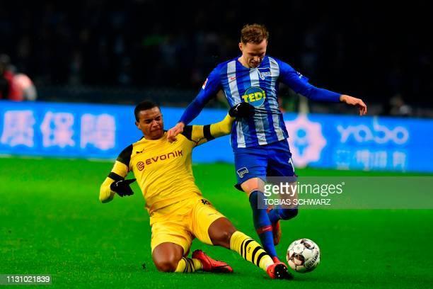 Berlin's Slovakian midfielder Ondrej Duda and Dortmund's Swiss defender Manuel Akanji vie for the ball during the German first division Bundesliga...
