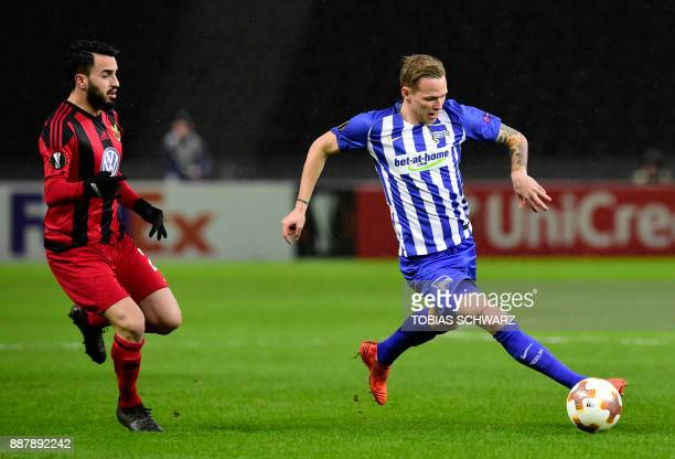 Berlin's Slovakian midfielder Ondrej Duda and Ostersund's Brwa Nouri vie for the ball during the UEFA Europa League group J football match Hertha BSC...