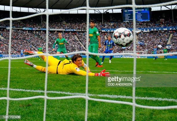 Berlin's Slovakian midfielder Ondrej Duda scores past Moenchengladbach's Swiss goalkeeper Yann Sommer during the German first division Bundesliga...