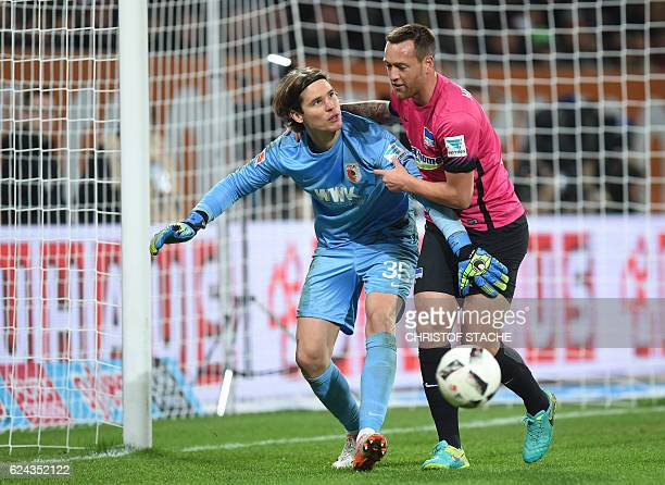 Berlin's striker Julian Schieber attacks Augsburg's Swiss goalkeeper Marwin Hitz vie for the ball during the German First division Bundesliga...