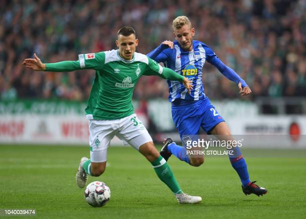 Berlin's Swiss midfielder Fabian Lustenberger and Bremen's German midfielder Maximilian Eggestein vie for the ball during the German first division...