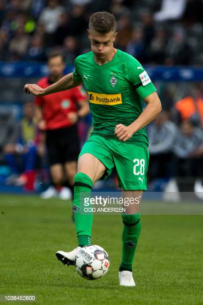 Berlin's Swiss midfielder Fabian Lustenberger runs with the ball during the German first division Bundesliga football match Hertha Berlin vs Borussia...