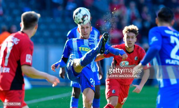 Berlin's Swiss midfielder Fabian Lustenberger vies with Freiburg's German forward Luca Waldschmidt during the German first division Bundesliga...