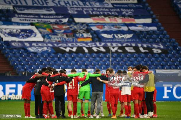 Berlin's team celebrate the 1-2 after the German first division Bundesliga football match FC Schalke 04 v Hertha Berlin on May 12, 2021 in...