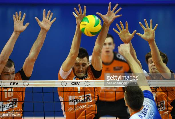 Berlin's Wouter Ter Maat Aleksandar Okolic and Robert Kromm defend a ball played by Istanbul's Antonin Rouzier during the men's volleyball Champions...