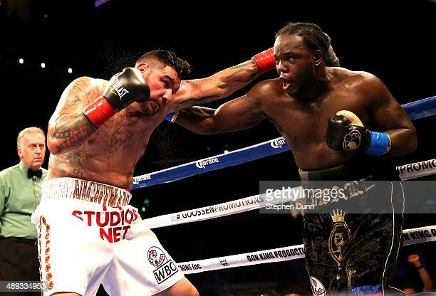 Bermane Stiverne battles Chris Arreola in their WBC Heavyweight Championship match at Galen Center on May 10 2014 in Los Angeles California Stiverne...