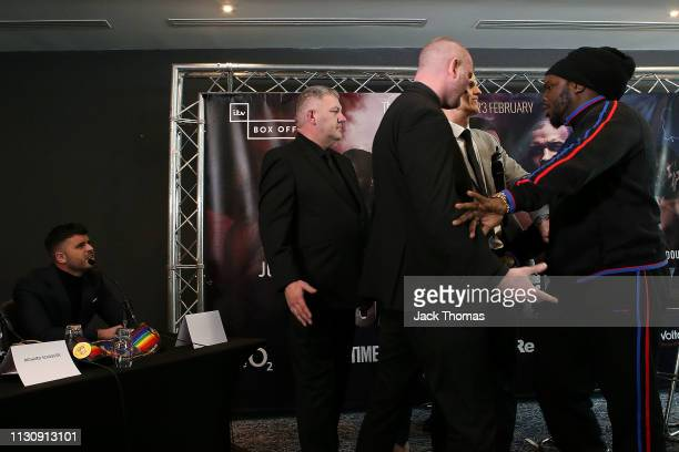 Bermane Stiverne is blocked by security as he has words with Sam Jones , the manager of Joe Joyce during the PBC and Poxton Sports undercard press...