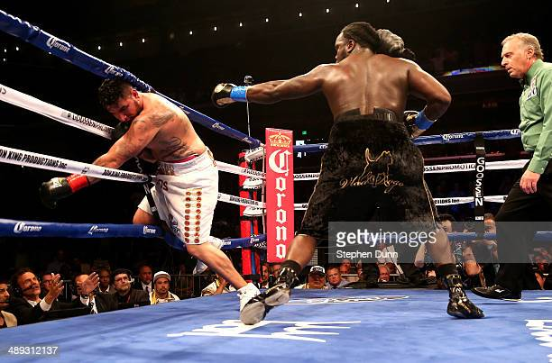 Bermane Stiverne knocks down Chris Arreola fir the second time in the sixth round of their WBC Heavyweight Championship match at Galen Center on May...
