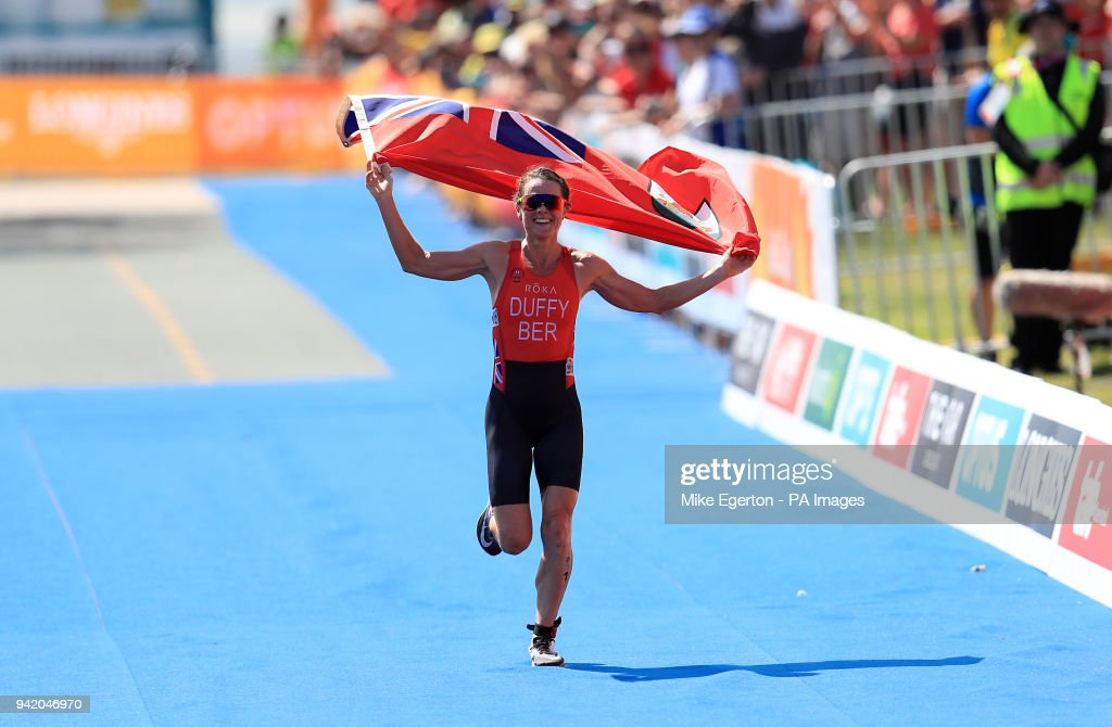 Bermuda's Flora Duffy celebrates winning gold in the Women's Triathlon Final at the Southport Broadwater Parklands during day one of the 2018 Commonwealth Games in the Gold Coast, Australia.