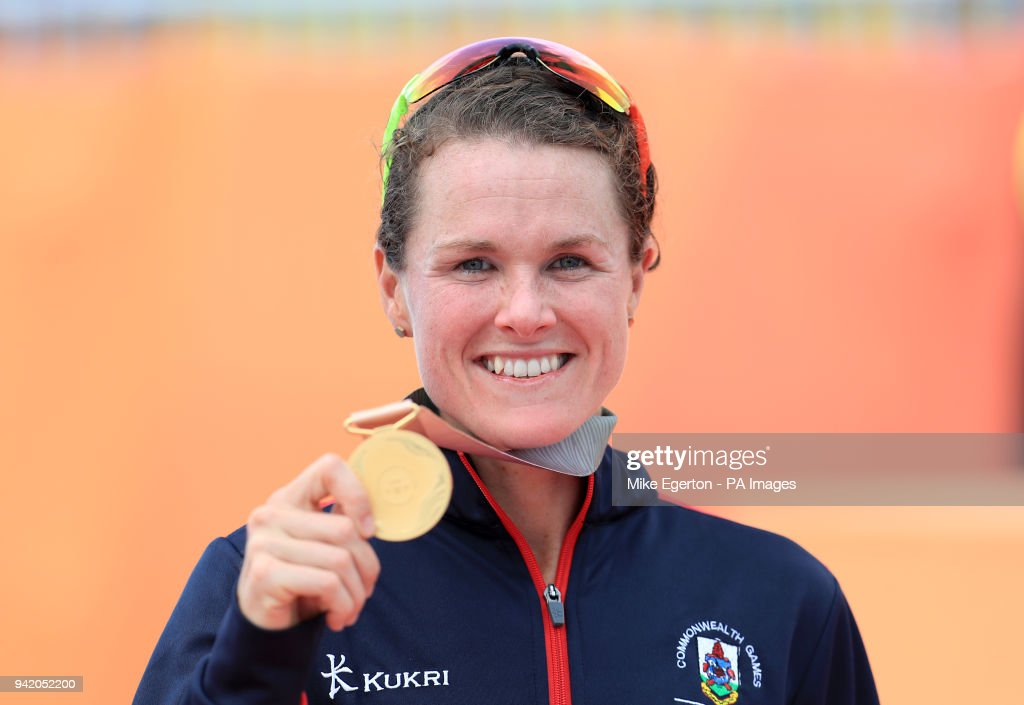 Bermuda's Flora Duffy on the podium after winning gold in the Women's Triathlon at the Southport Broadwater Parklands during day one of the 2018 Commonwealth Games in the Gold Coast, Australia.