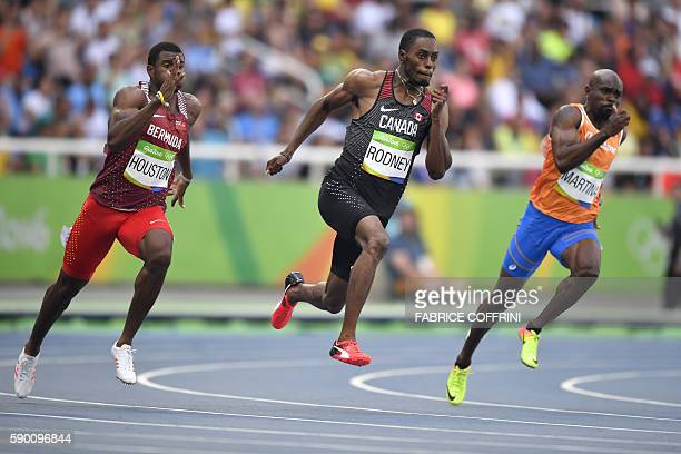 Bermuda's Harold Houston Canada's Brendon Rodney and Netherlands' Churandy Martina compete in the Men's 200m Round 1 during the athletics event at...