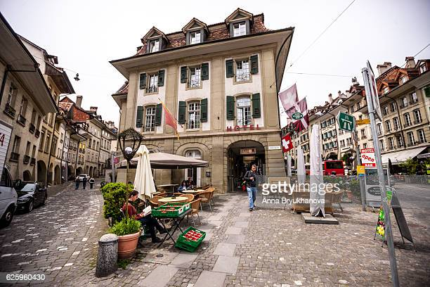 bern street in old town, switzerland - bern stock photos and pictures