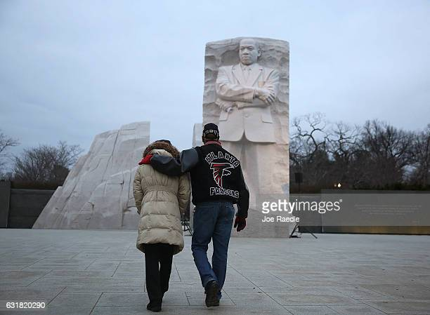 Bernadette Andrews and Keith Andrews walk together as they visit the Martin Luther King Jr memorial on the day that honors him on January 16 2017 in...