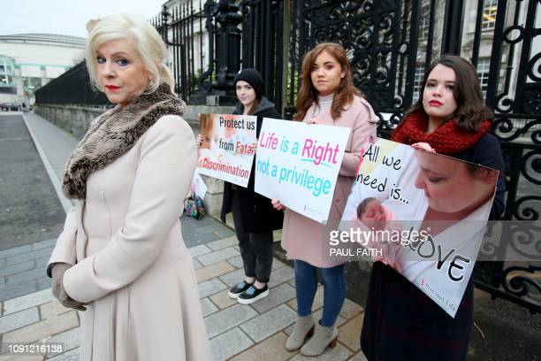 Bernadette 'Bernie' Smyth founder of prolife campaign group Precious Life stands with antiabortion activists holding placards outside Belfast High...