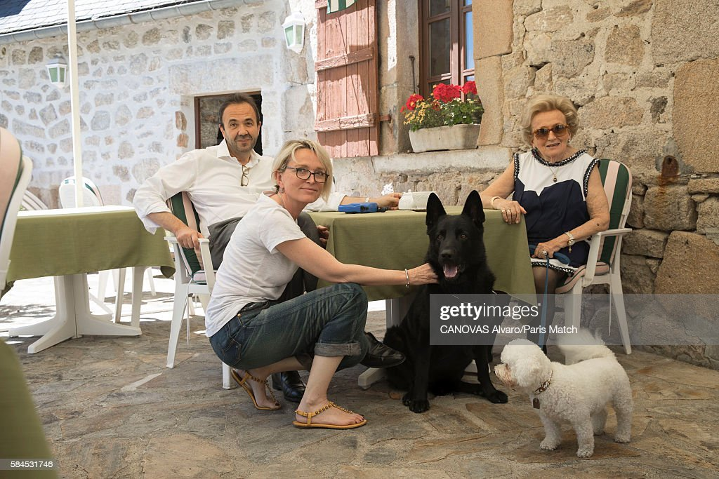 Bernadette Chirac, former first lady with her daugther Claude Chirac and here husband Frederic Salat-Baroux are photographed for Paris Match on July 08, 2016 in Corrèze, France.
