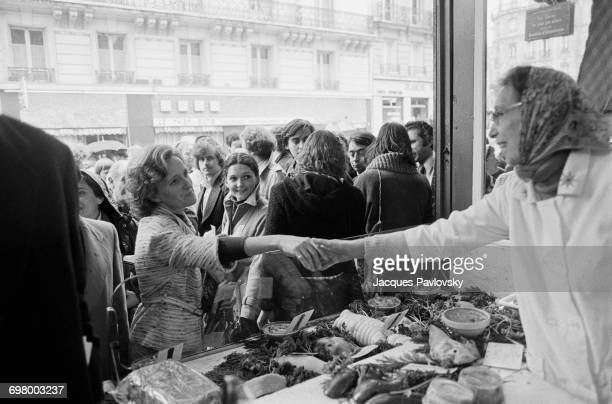 Bernadette Chirac wife of Jacques Chirac visiting a market in Place Maubert during her husband's campaign to be elected Mayor of Paris France 24th...