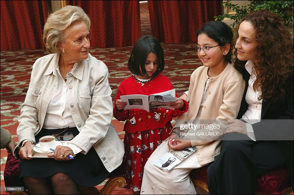 """The two Afghan girls operated in Paris thanks to """"La Chaine de l'Espoir"""" received at the Elysee Palace in Paris, France on September 10, 2003. : News Photo"""