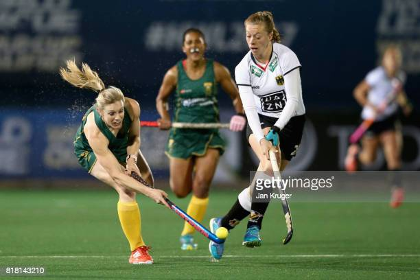 Bernadette Coston of South Africa and Franzisca Hauke of Germany battle for possession during the Quarter Final match between Germany and South...