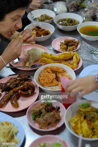 Bernadette Estrada of Portland Ore USA explores a myriad of dinner delights bought at a night market in Chiang Mai She was on a culinary tour led by...