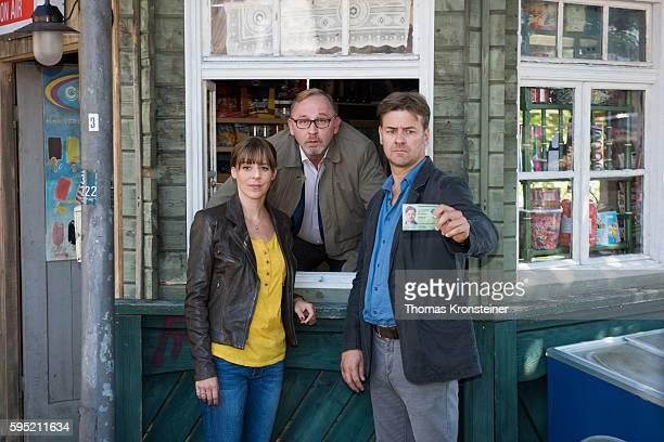 Bernadette Heerwagen Alexander Held and Marcus Mittermeier pose at the on set photocall for the film 'Muenchen Mord Auf der Strasse nachts allein' on...
