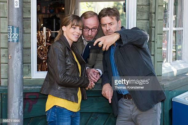 Bernadette Heerwagen Alexander Held and Marcus Mittermeier take a selfie at the on set photocall for the film 'Muenchen Mord Auf der Strasse nachts...
