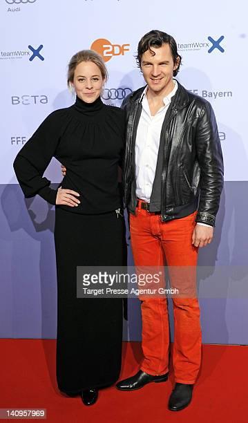 Bernadette Heerwagen and Felix Klare attend the premiere of 'Muenchen 72 Das Attentat' at Astor Film Lounge on March 7 2012 in Berlin Germany